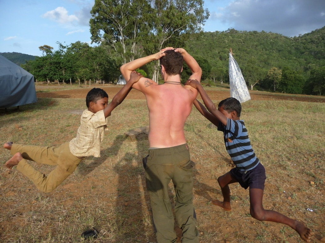 A backpacker volunteering in India with children