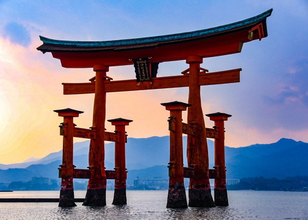 Sunrise over a a famous shrine attraction in a lake in southern Japan