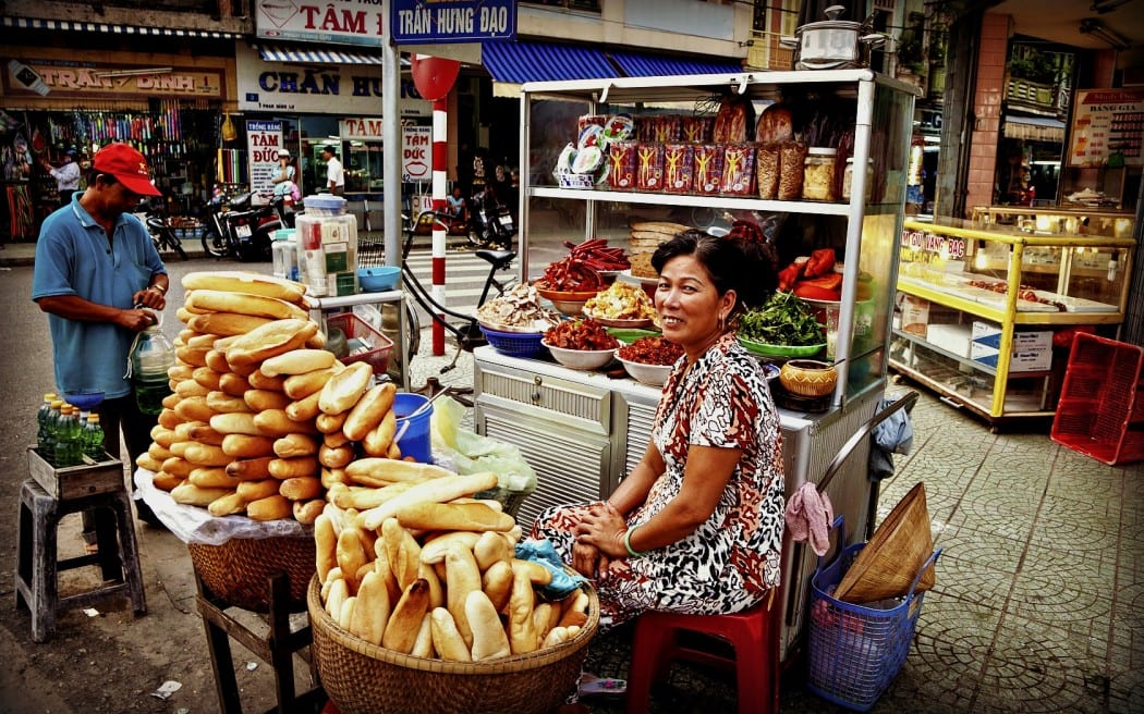 Street food stall in Vietnam selling bread rolls and Banh Mi