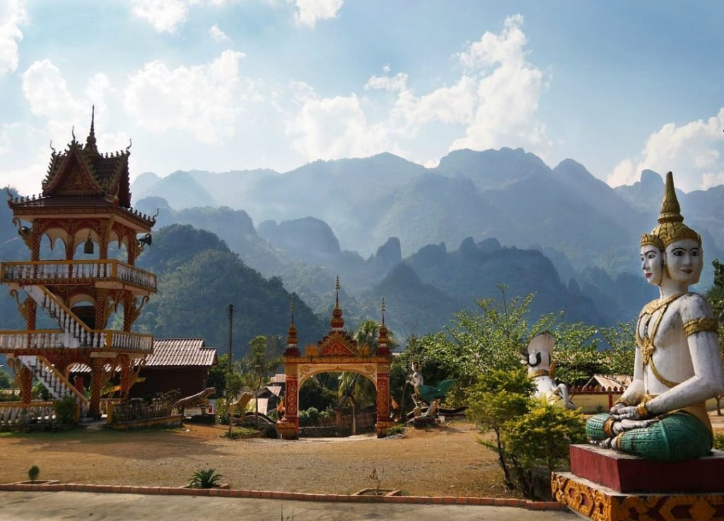 A temple and statue in the mountains while backpacking Laos