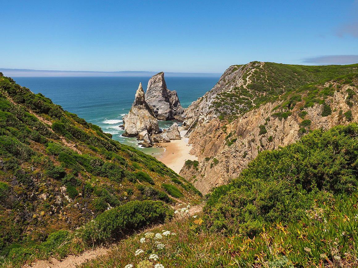 Paradisiacal ursa beach with greenery in Sintra near Lisbon, Portugal