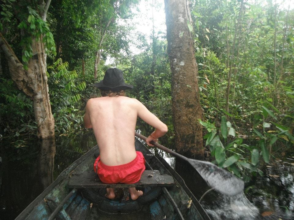 traveling by boat in the Amazon rainforest