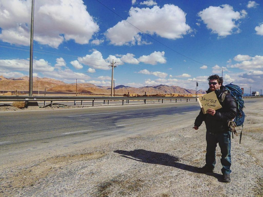 Will holding up a hitch hiking sign in Iran