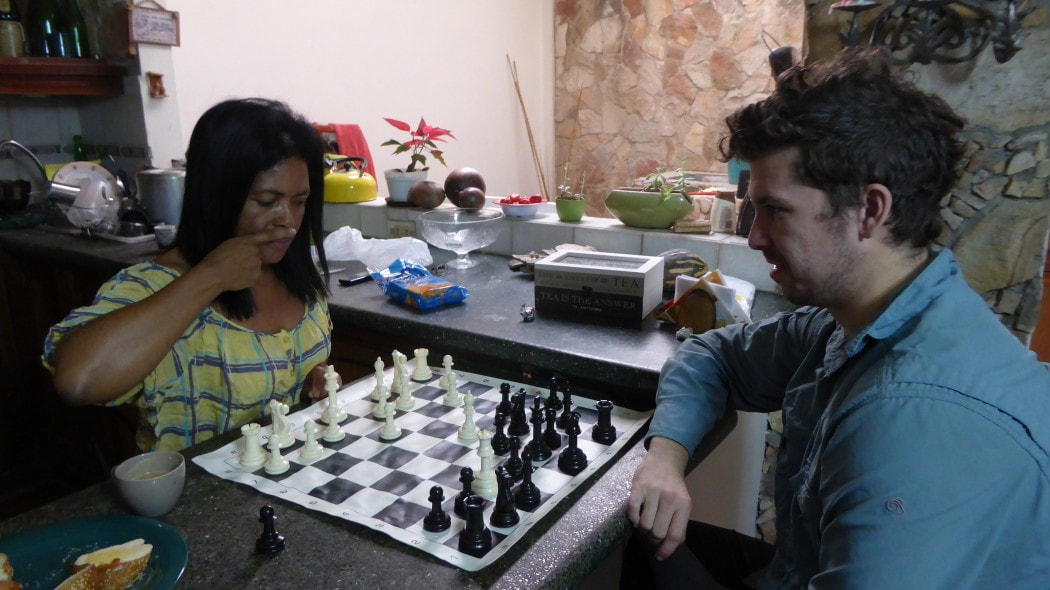 Playing chess with a host while backpacking