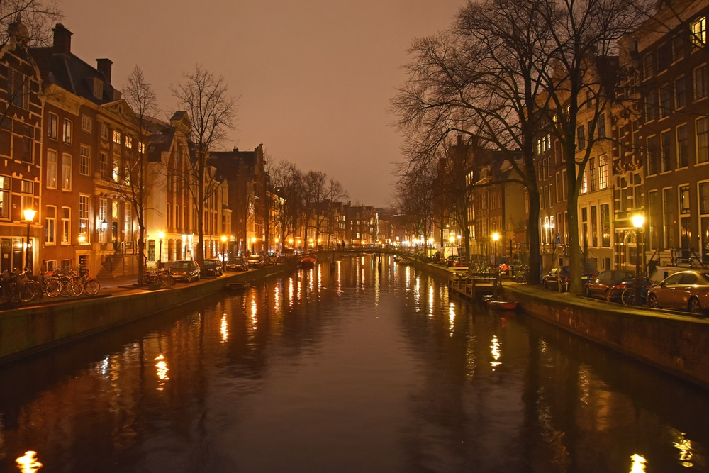 Visiting Amsterdam at night and viewing the lit up canals