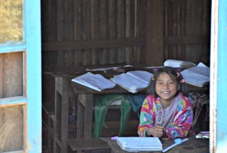 smiling girl while studying