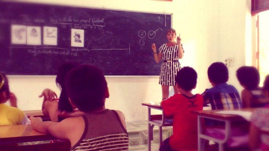 A teacher teaching English abroad