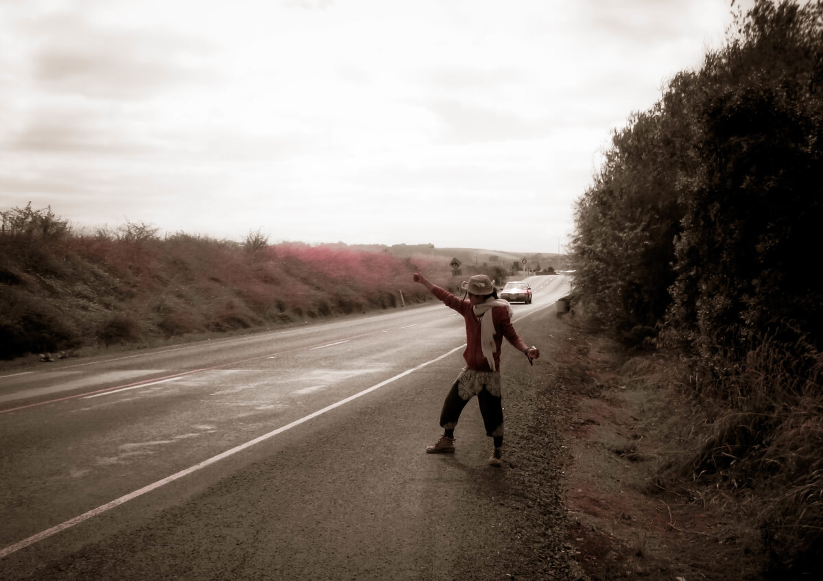 A man hitchhiking on the South Island of New Zealand