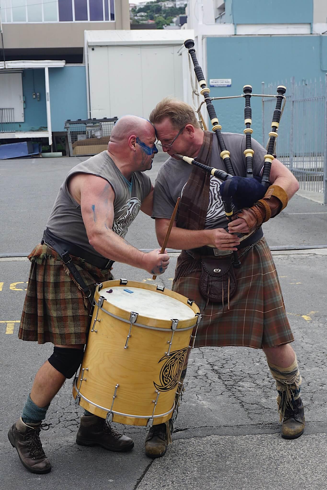 Two Kiwi men putting on a performance at CubaDupa festival in Wellington
