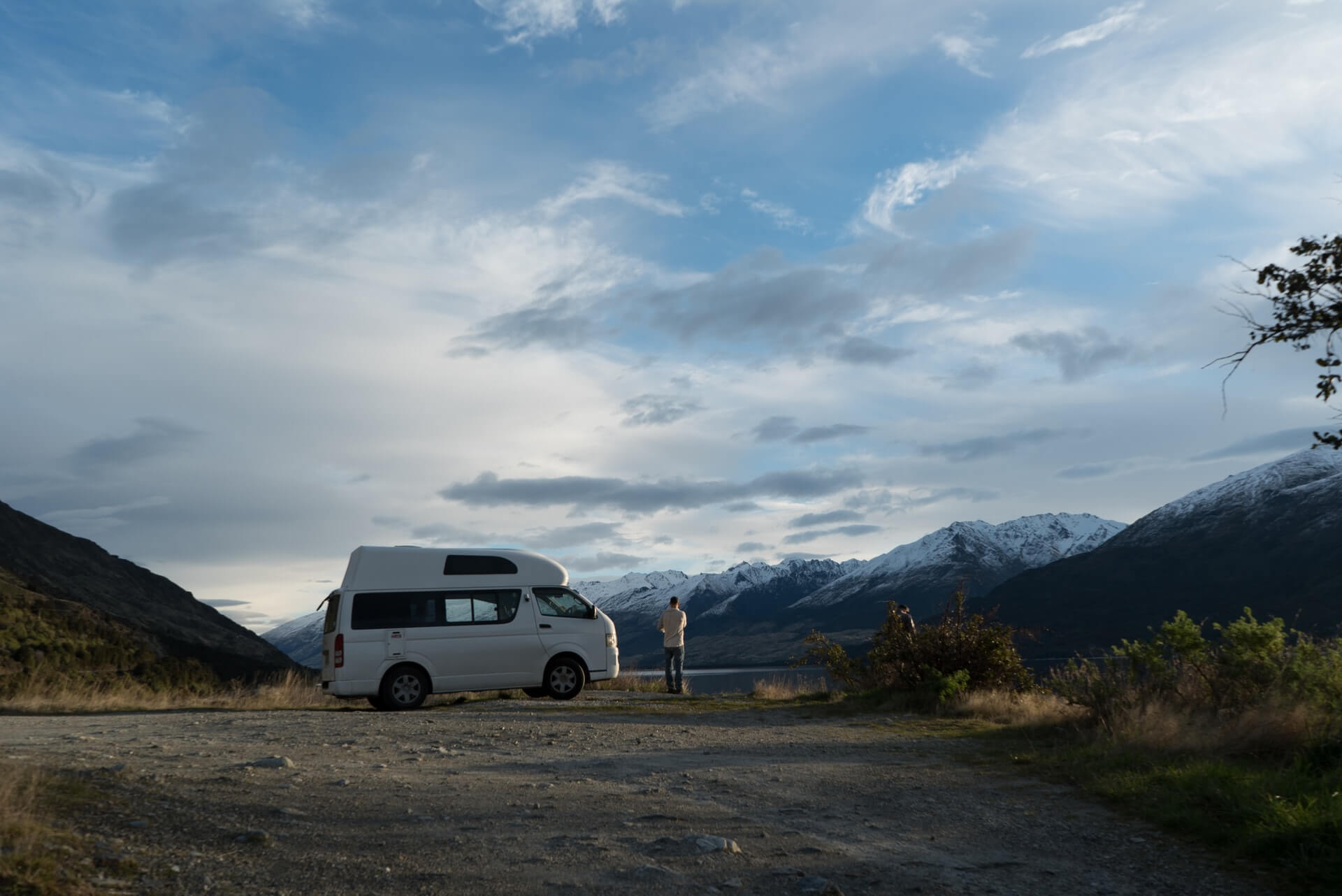A man travelling the Otago region by campervan camping outside Queenstown