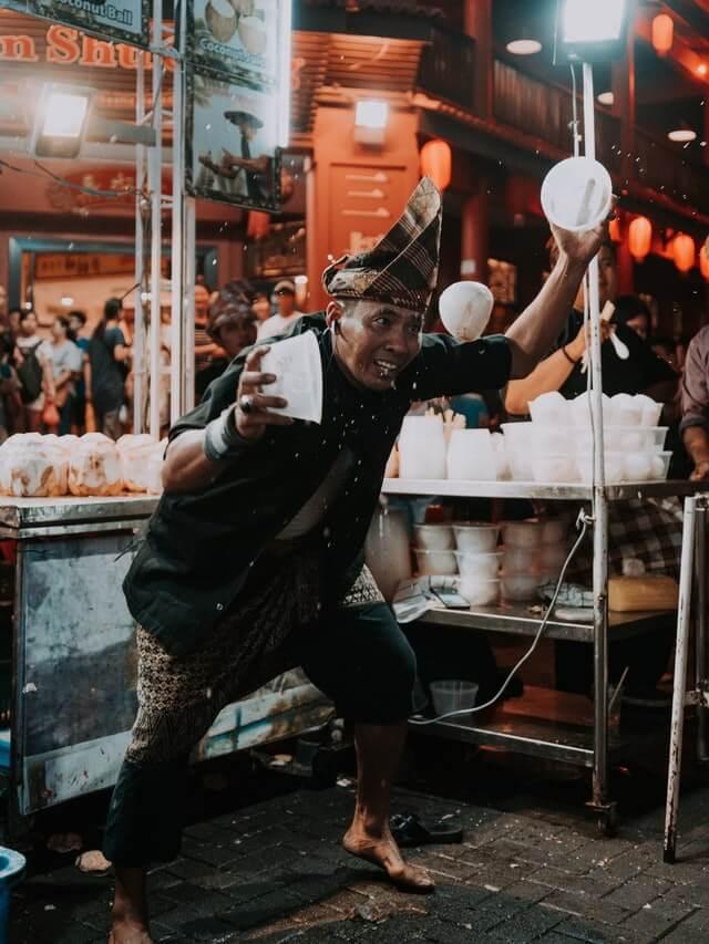 An eccentric Malaysian man running a street food stall in Kuala Lumpur