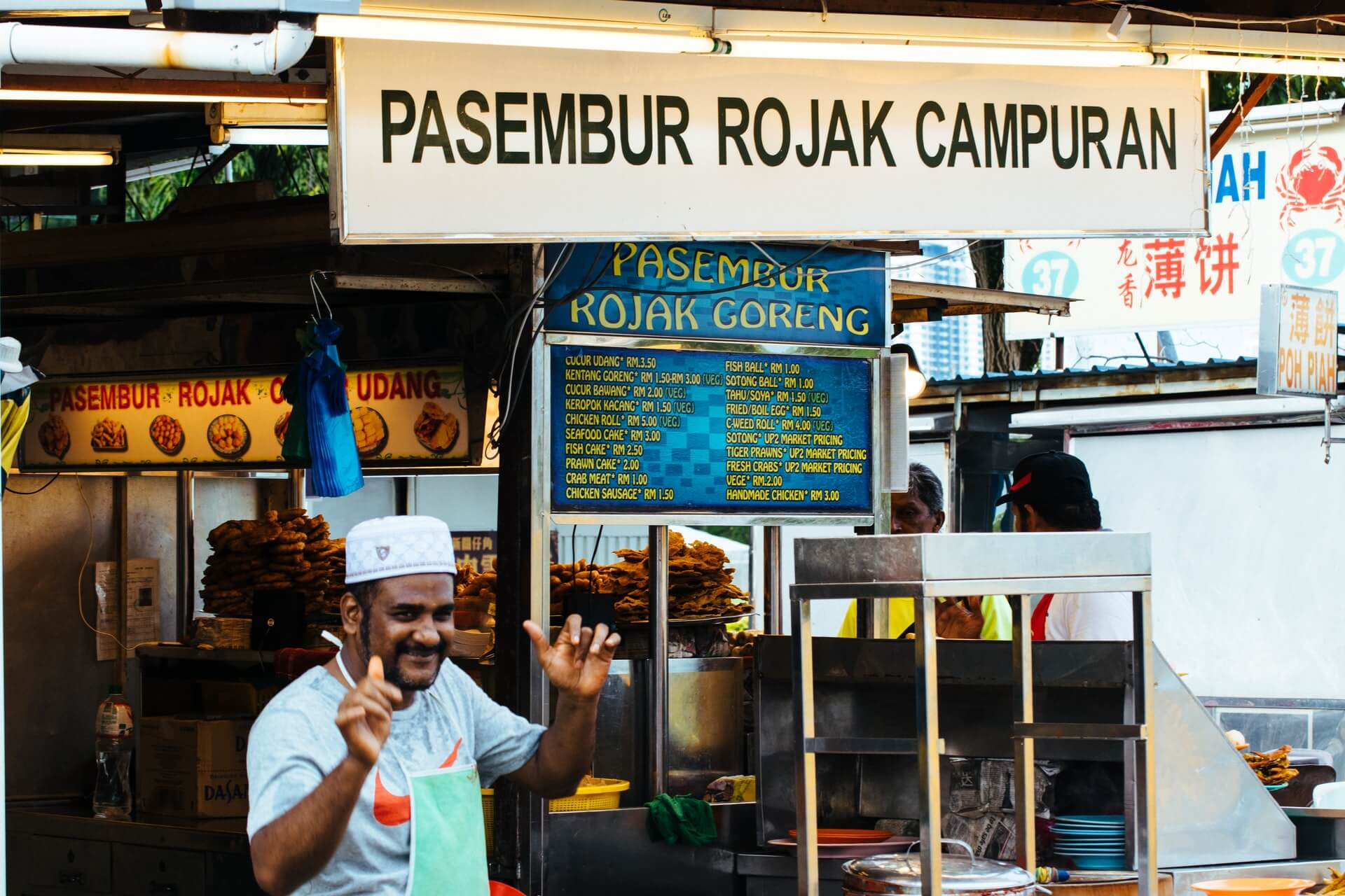 A man serving street food goreng in Kuala Lumpur, Malaysia