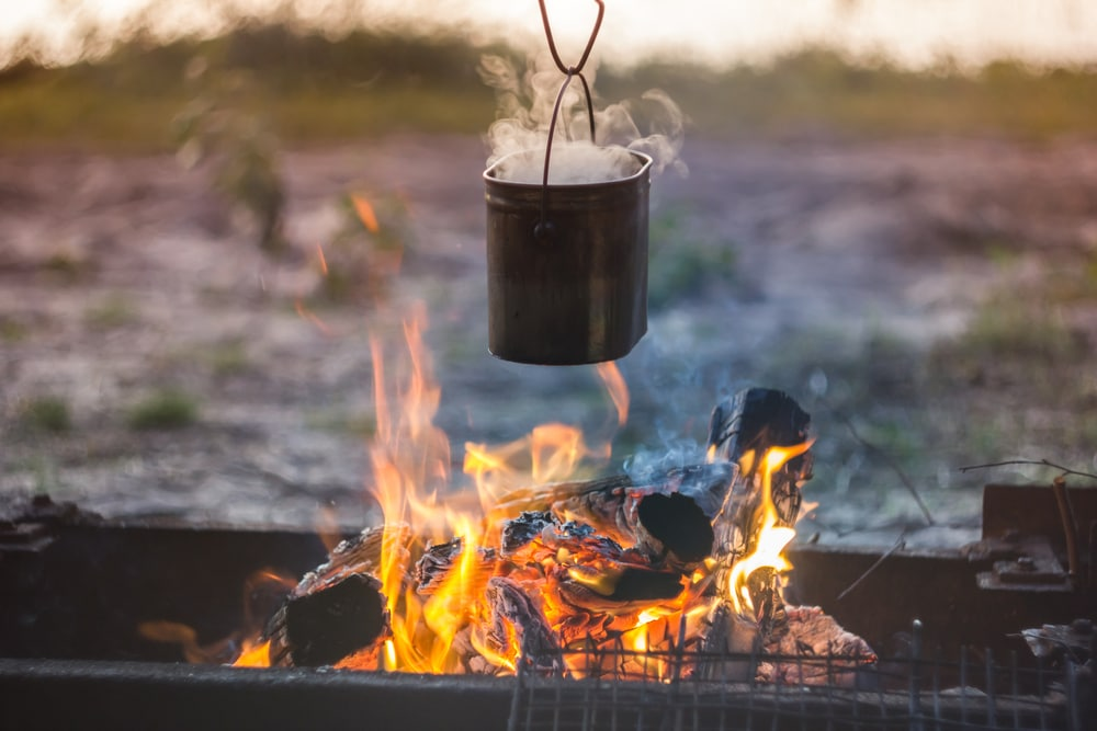 Cooking on a campfire with an old-school billy