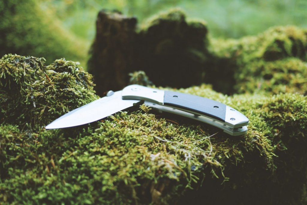 A knife is a camping essential idea for hikers and adventurers