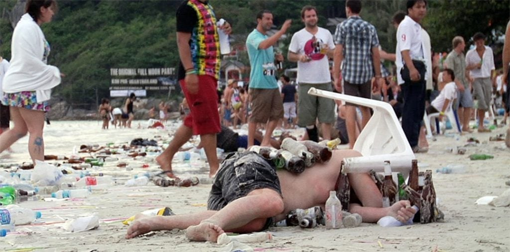 An unconscious man after a Full Moon Party in Thailand