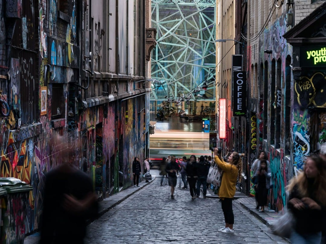 Lady clicking the wall art in Hosier Lane, Melbourne, Australia