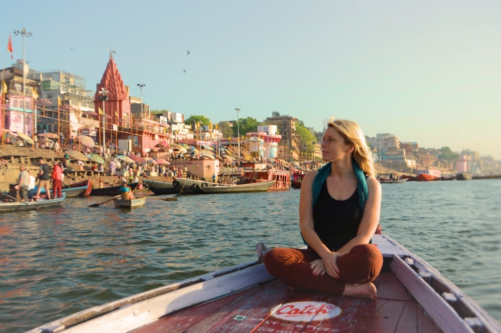 Solo female traveller backpacking in Varanasi at the Ganges River