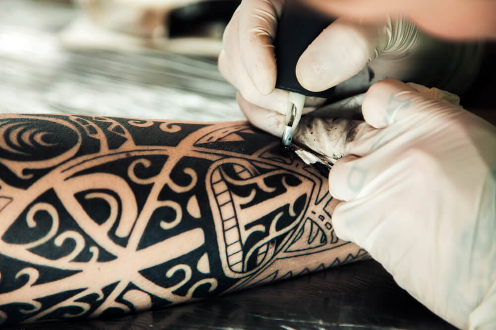 Recieving a Polynesian tattoo in Tahiti