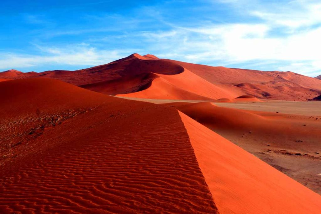 The amazing red sand dunes of Sossusvlei while backpacking Namibia