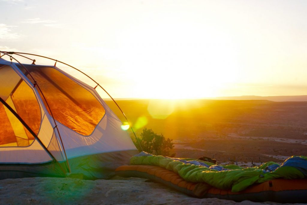 A backpacking tent, sleeping bag and pad - all you need for minimalist camping gear