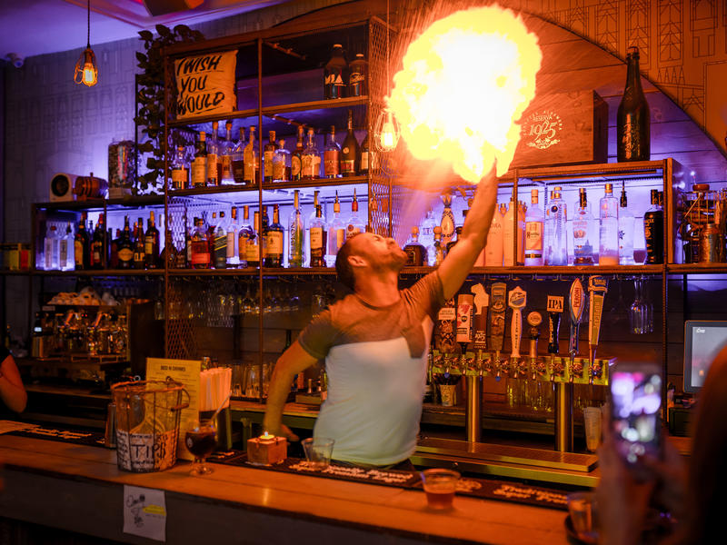 Bartender breathing fire at a cool Europe hostel
