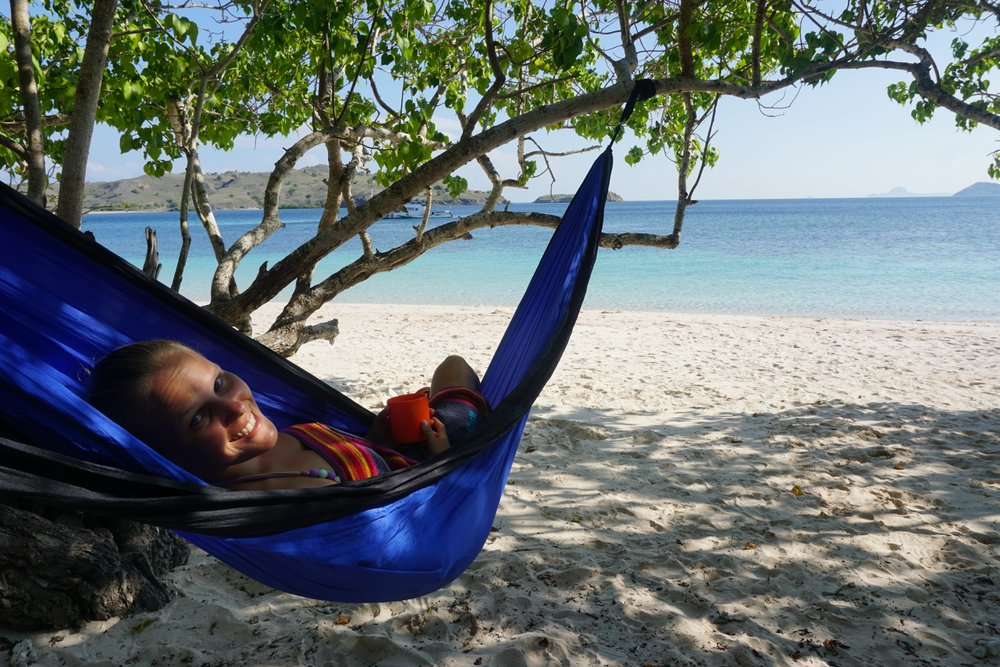 Using a hammock on a beach in Indonesia