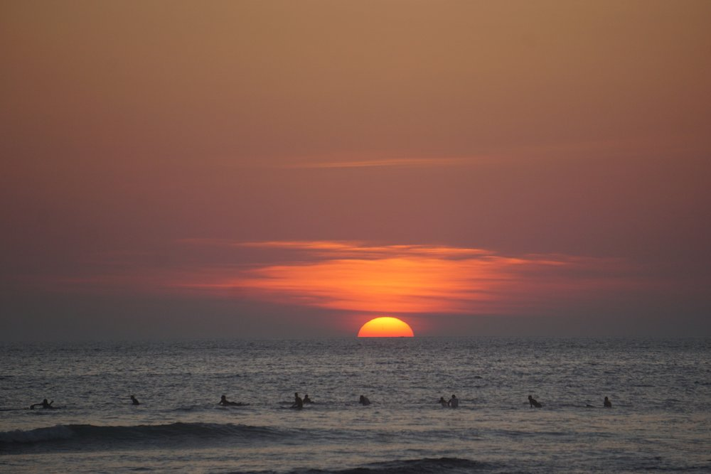 Surfing in Canggu at sunset