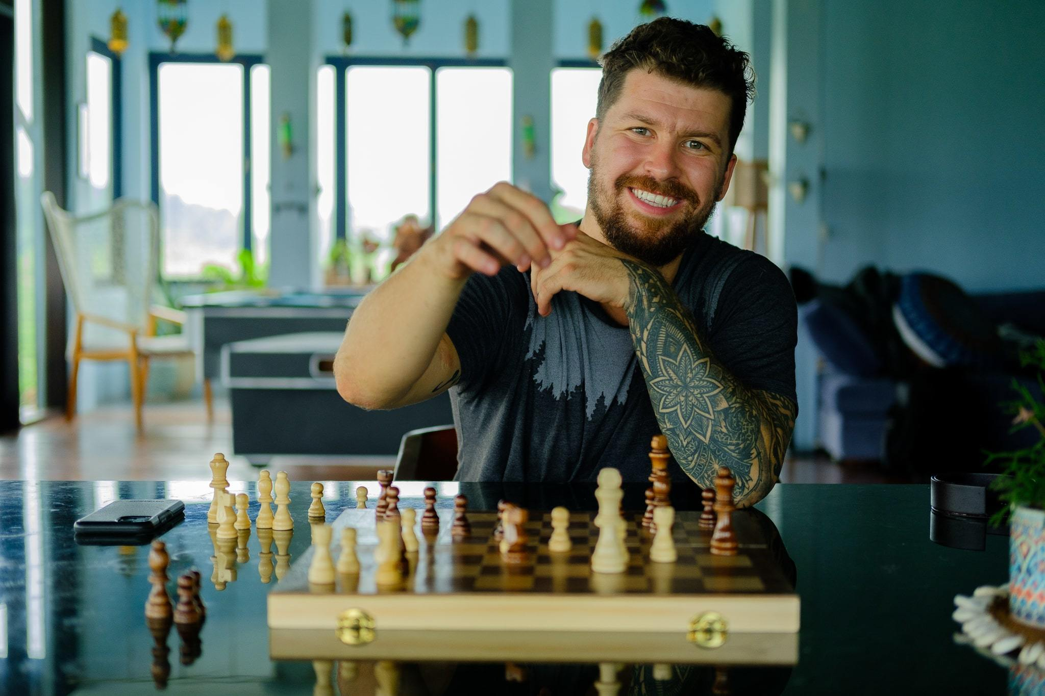 Will Hatton playing chesss representing his prowess in enarning passive income online through affiliate marketing