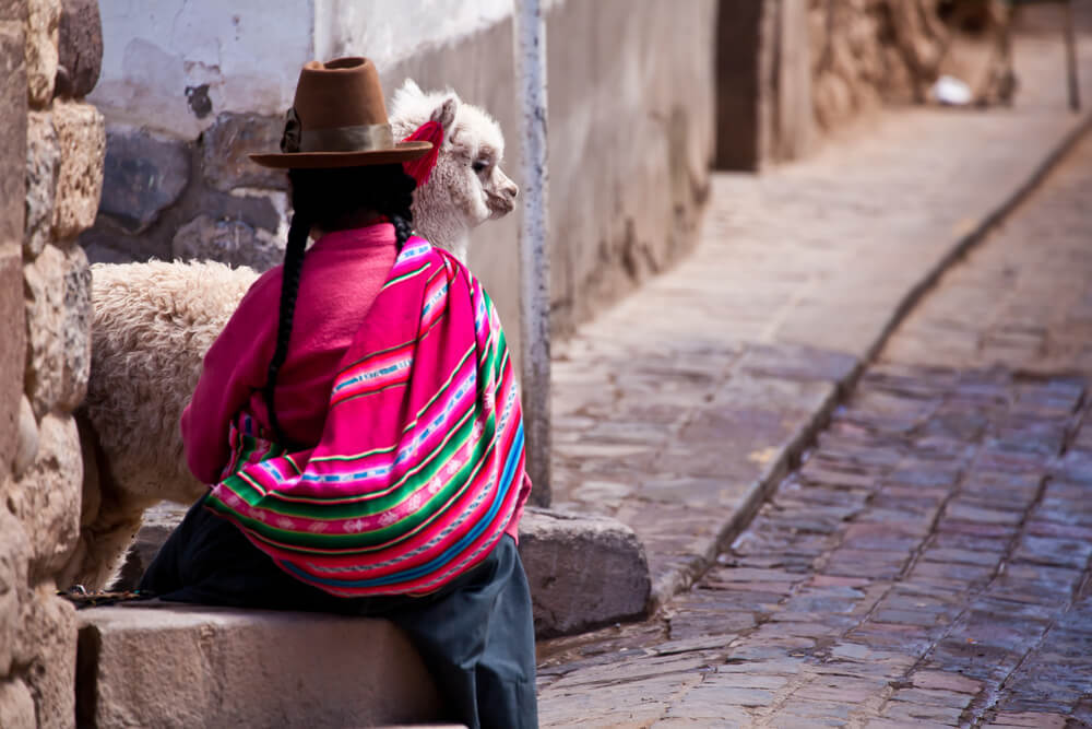 Peruvian woman and her pet
