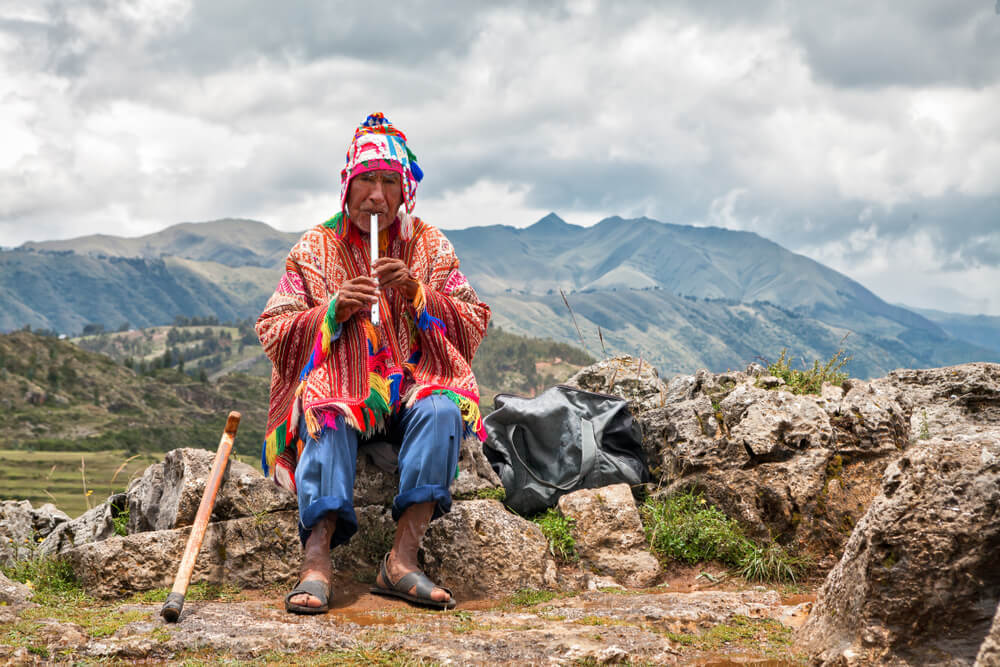 An old man in Peru playing the flute