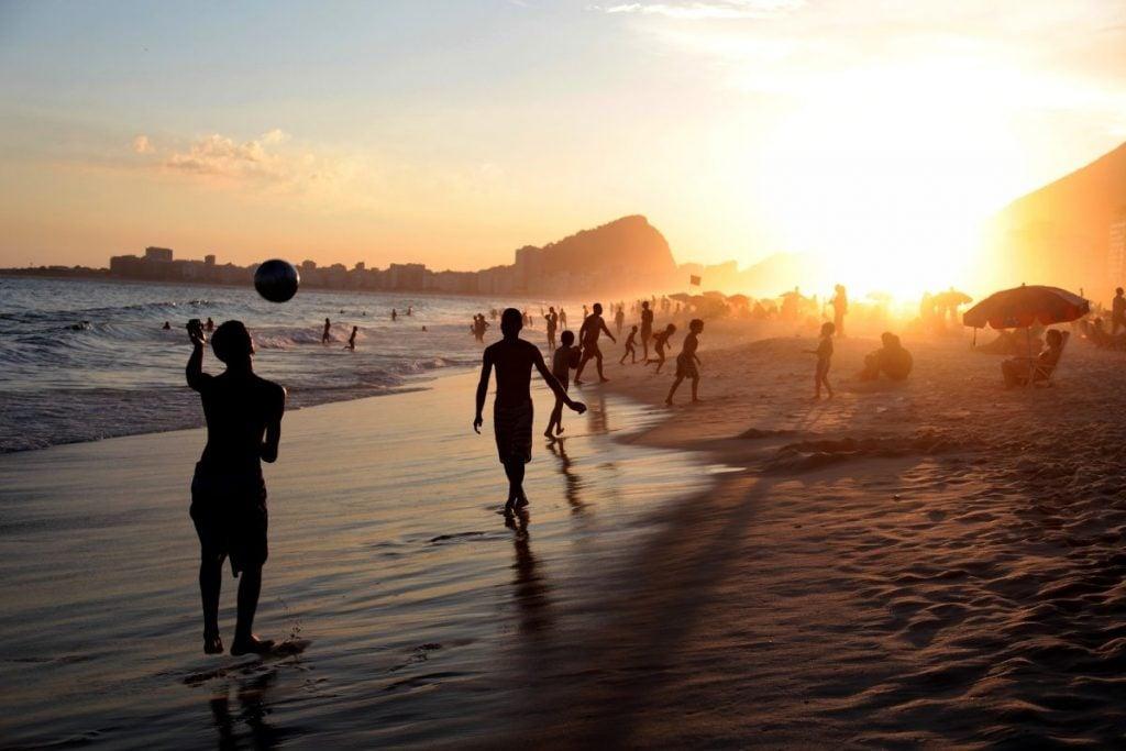 Brazilians playing on Copacabana Beach at Sunset Brazil