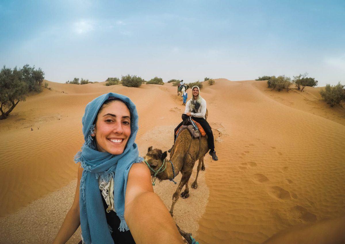 Woman wearing shawl as headwrap in the desert