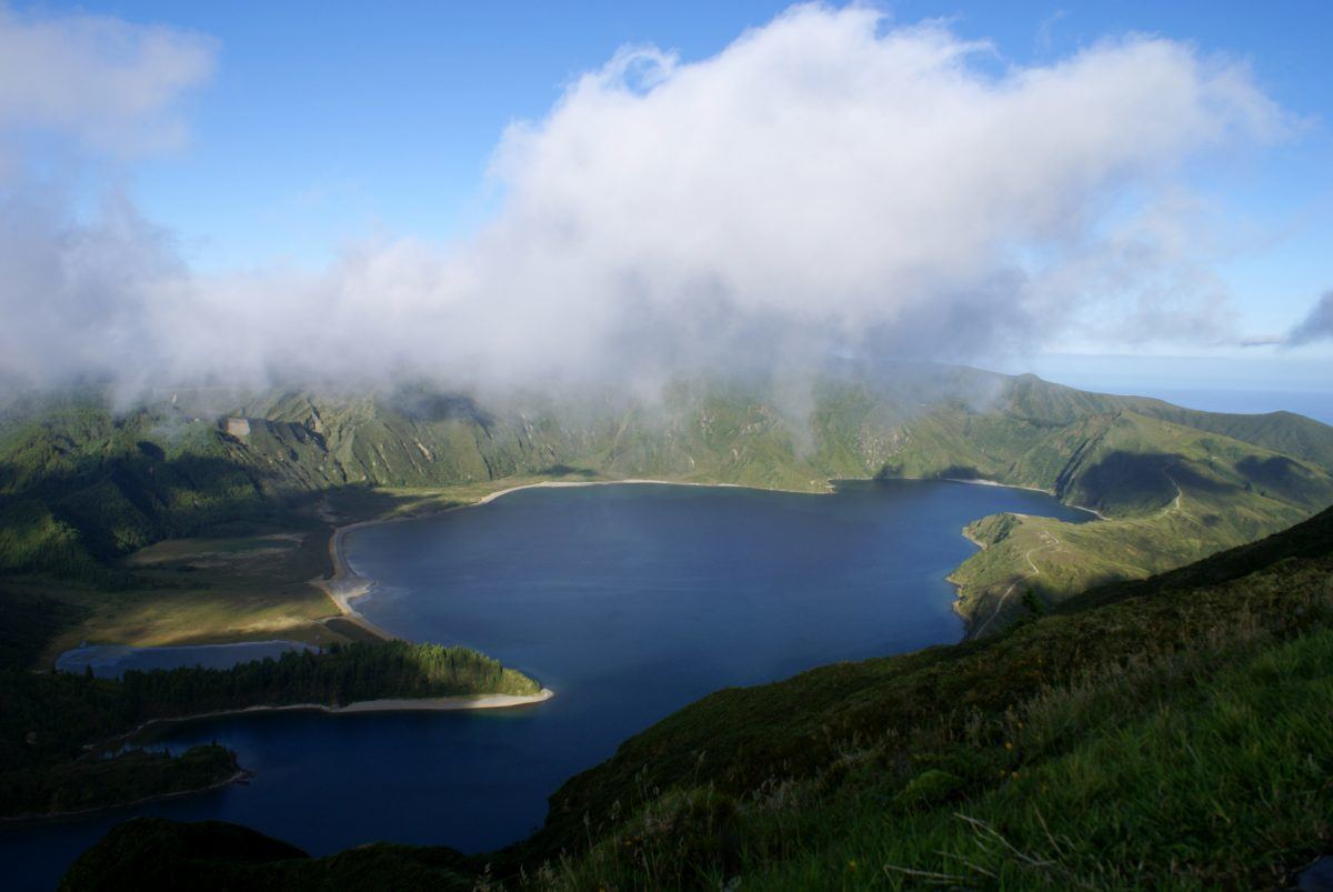 clouds over the lagoa do fogo in the azores