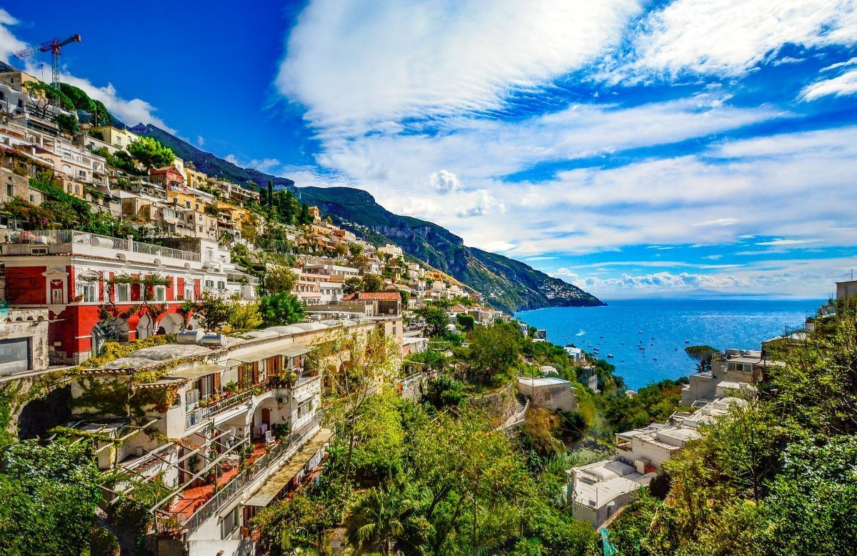 a village atop a cliff on the amalfi coast