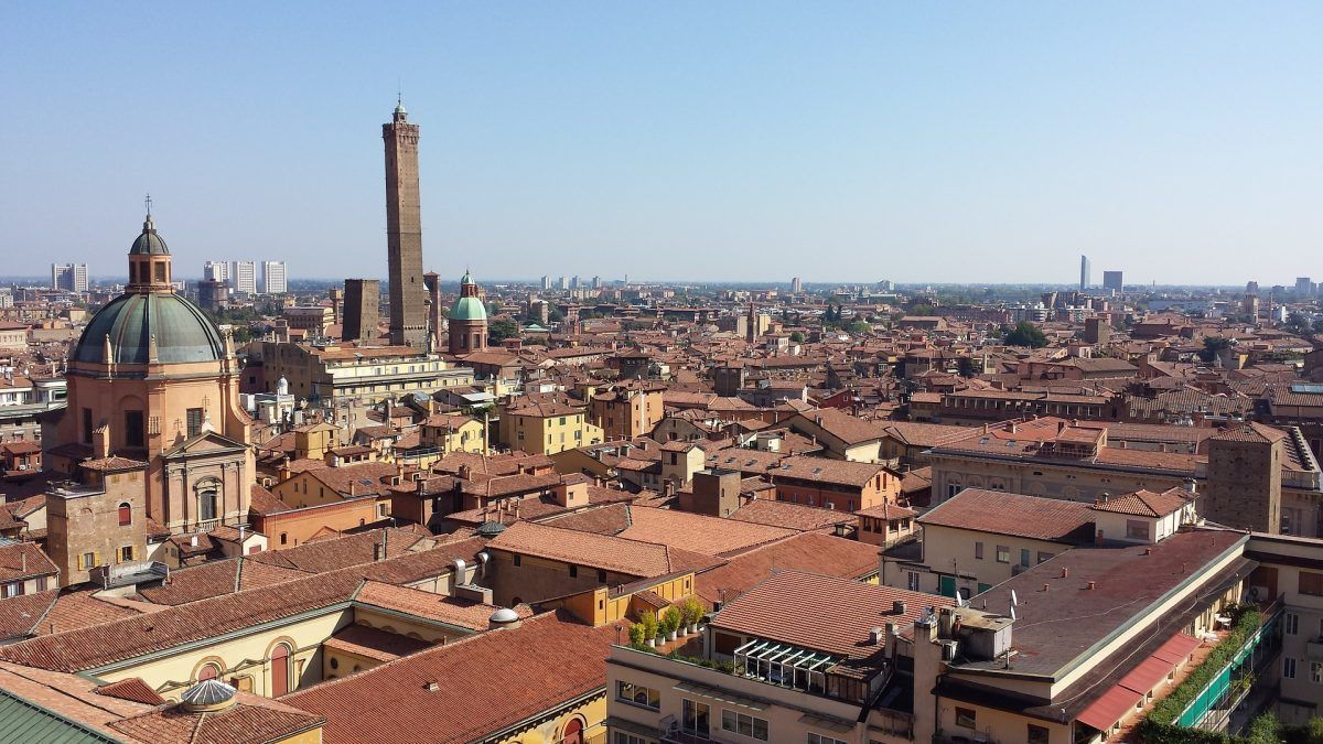 terracotta rooftops and cityscape of bologna italy
