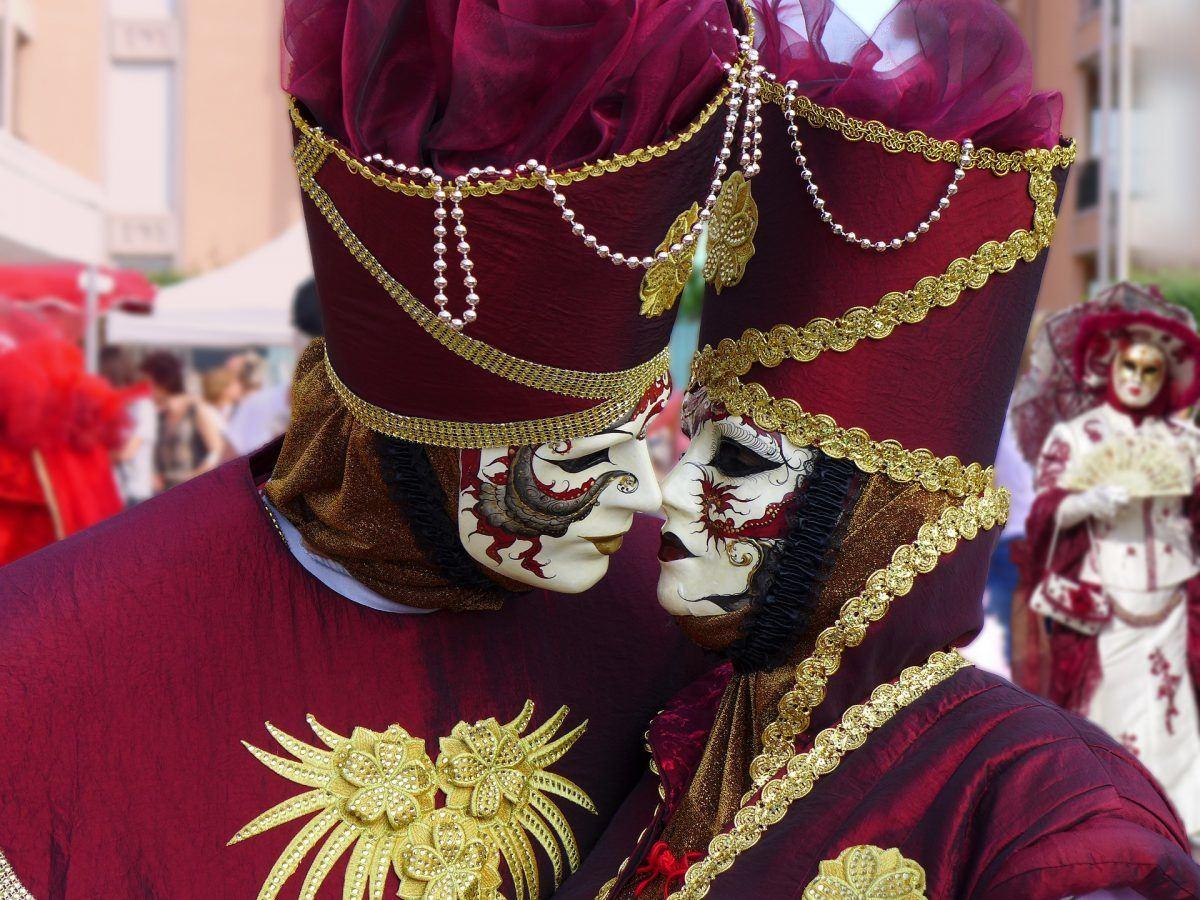 masked celebrators attending carnevale in venice italy