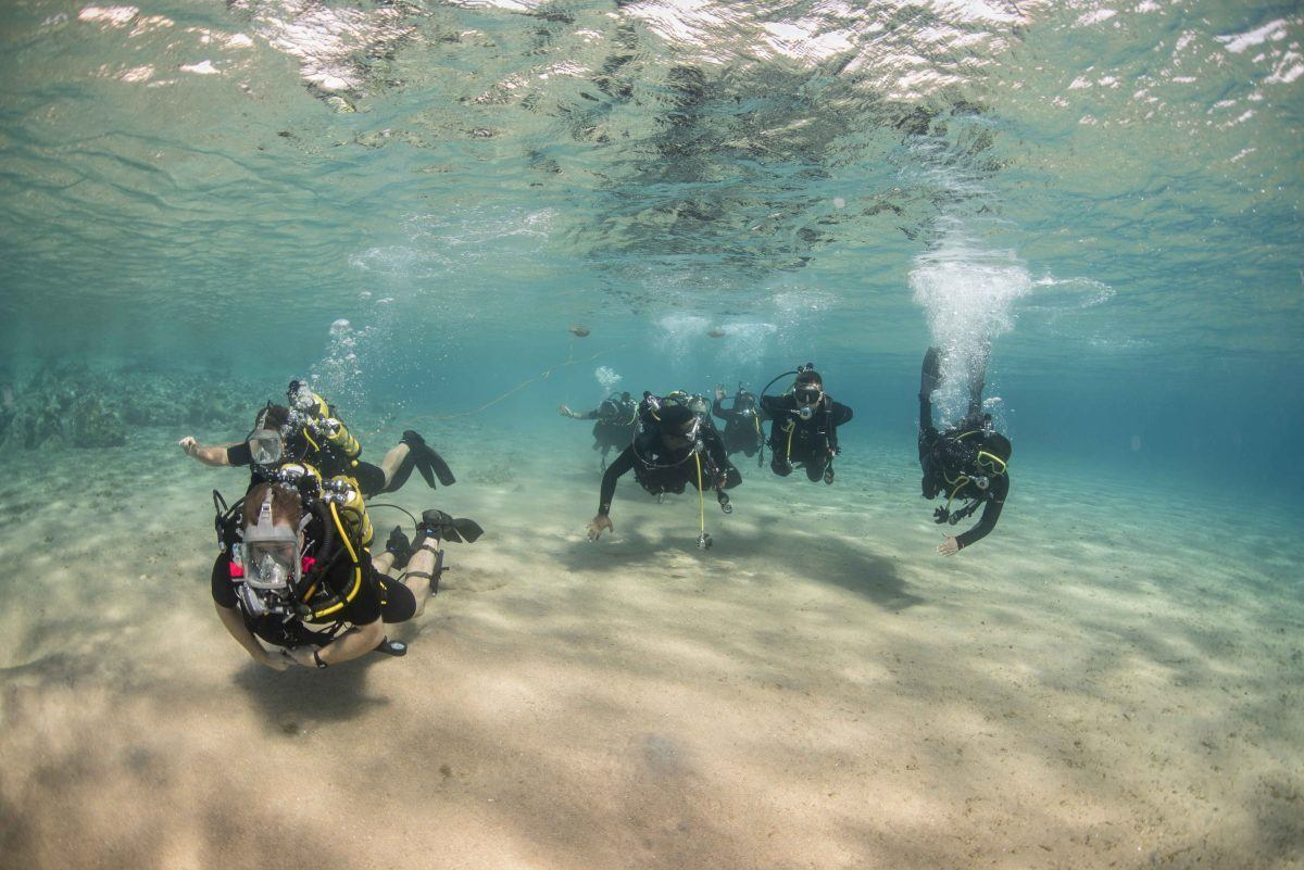 Group diving in the Red Sea for an adventurous thing to do in Israel