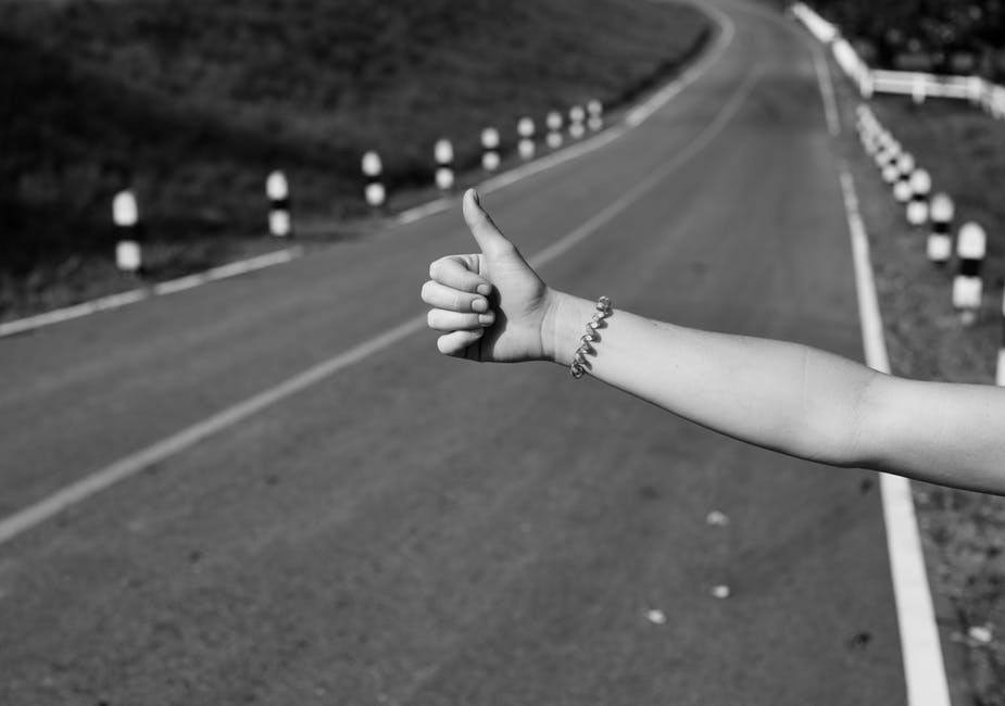 A woman's hand hitchhiking in Greece