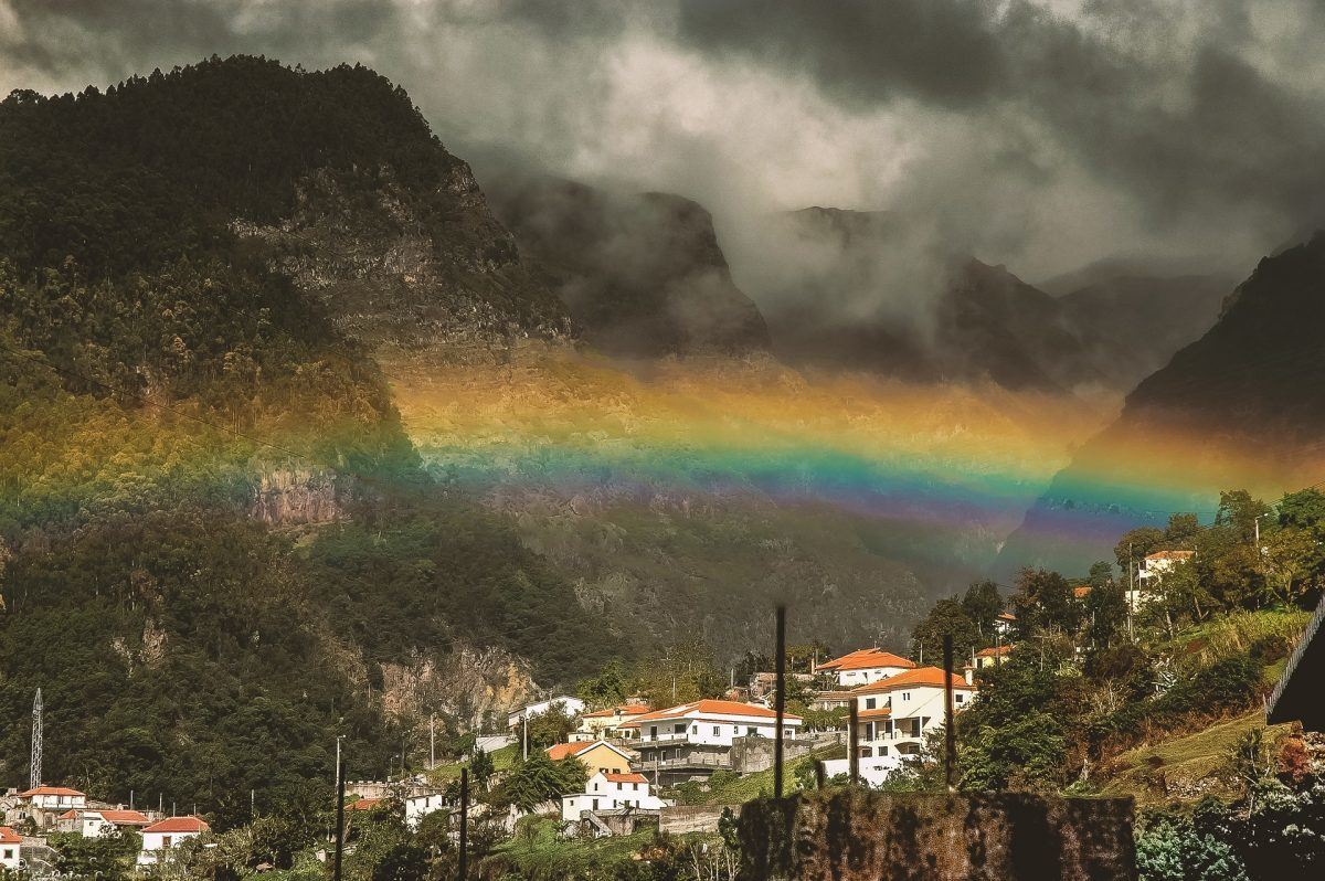 rainbow across town in madeira portugal