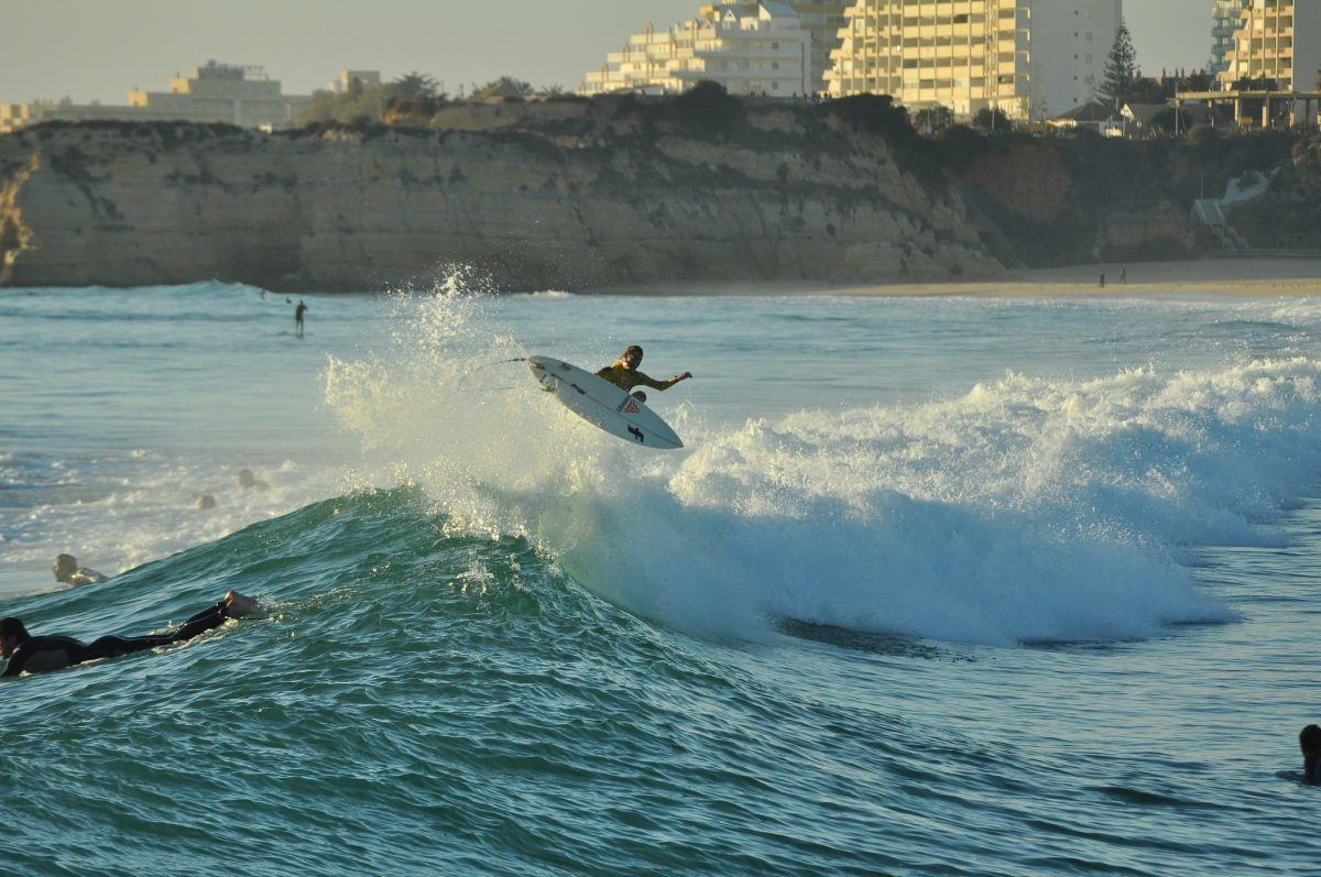 Surfer catching a awave in the algarve portugal