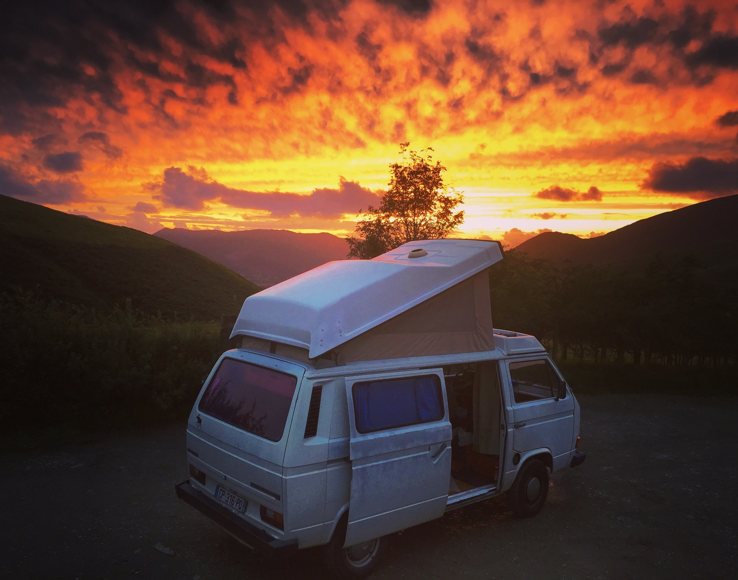 A sweet van setup under a sunset