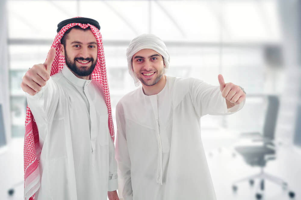 A couple Arabs excited about a free visa for Jordan