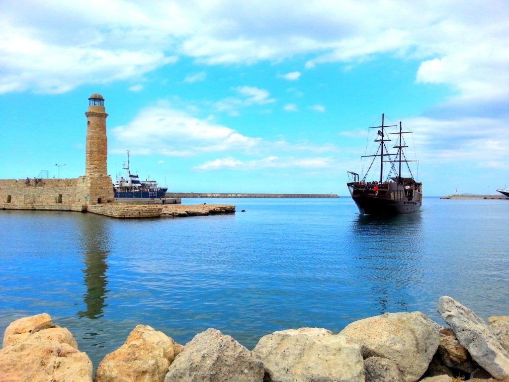 A lighthouse and ship at Rethymno - Popular tourist place in Crete
