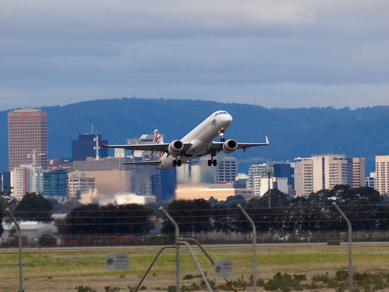 plain taking off adelaide international airport