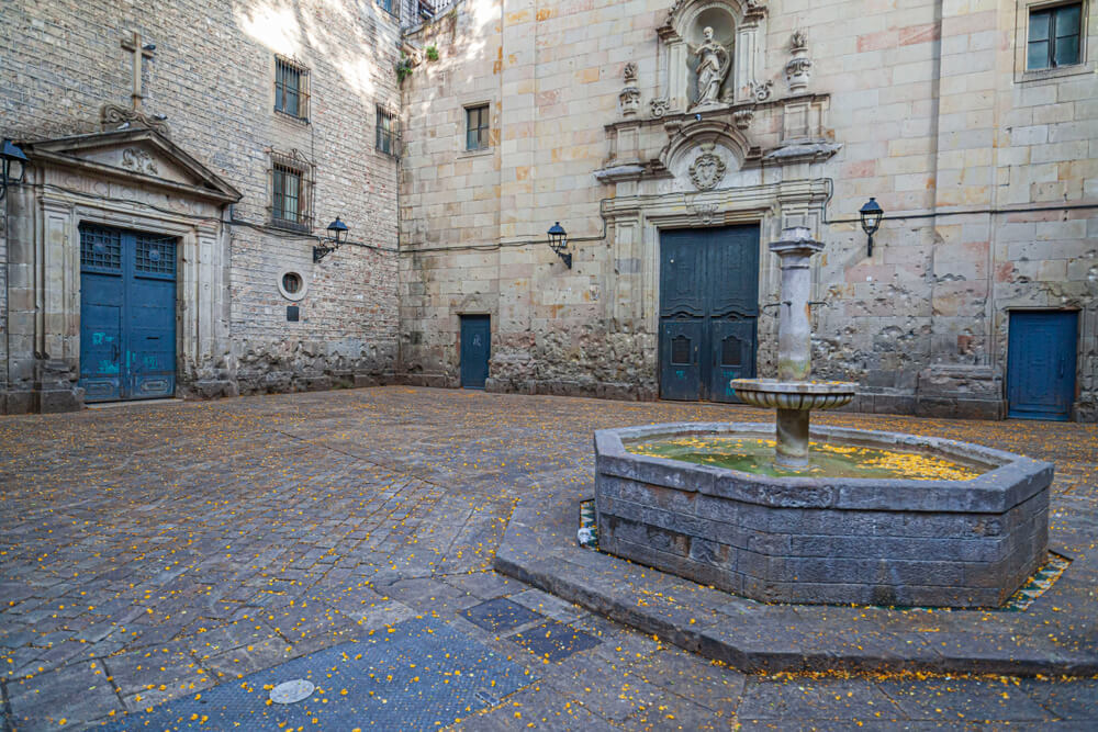 Sit and reflect at the Placa de Sant Felip Neri