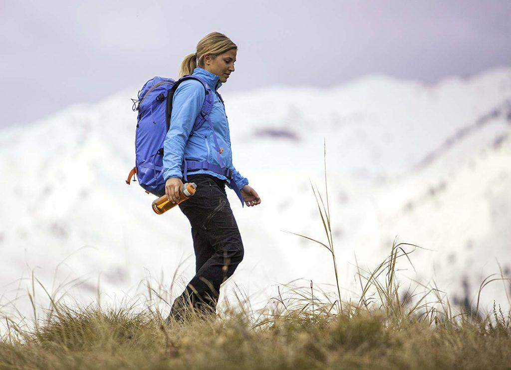 A woman with an ultralight filtered bottle for hiking