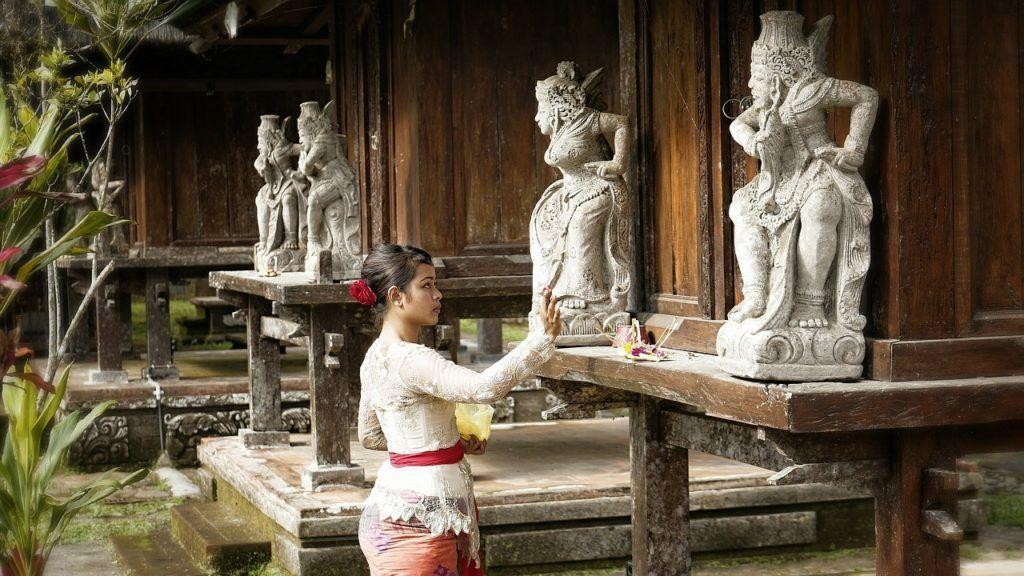 woman making offering bali