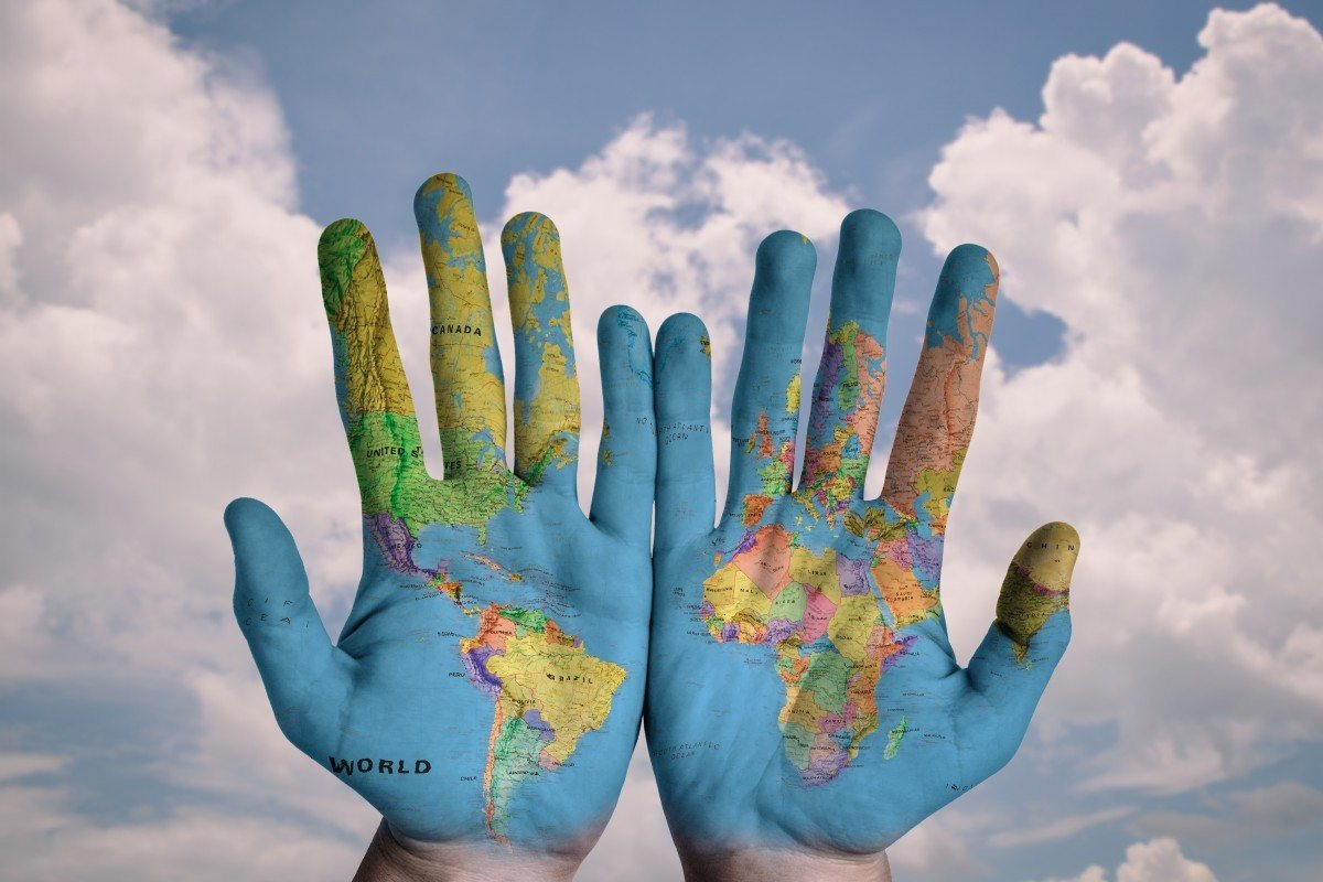 Hands with the world map on them