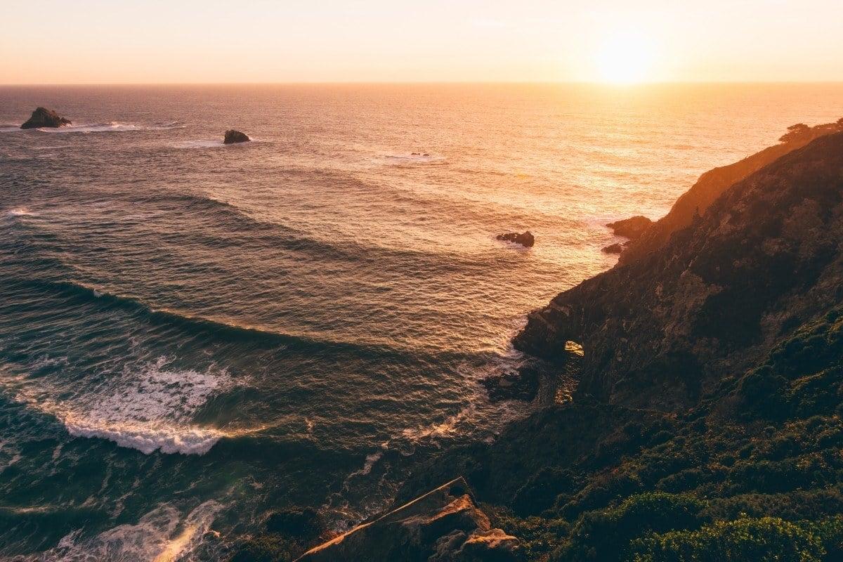 big sur camping on a sunset coastline