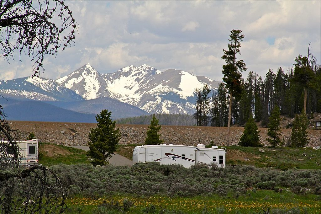 rv trailer in colorado woods with mountains